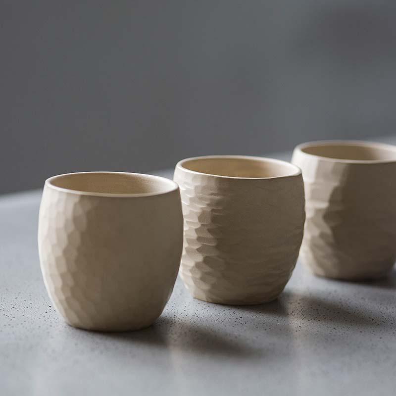 White Sculpted Jianshui Zitao Purple Clay Teacup