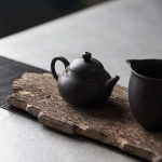 Engraved Fish Jianshui Zitao Purple Clay Teapot