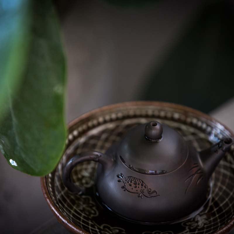 Engraved Fish Jianshui Zitao Purple Clay Teapot