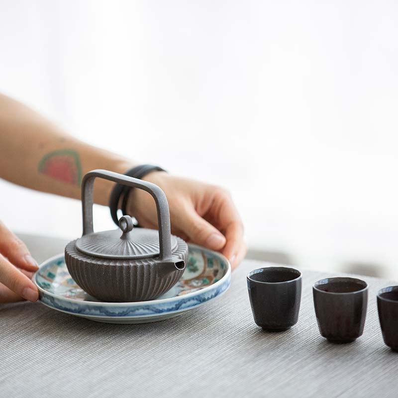 Tiliang (Handle) Sculpted Yixing Hui Duanni Teapot